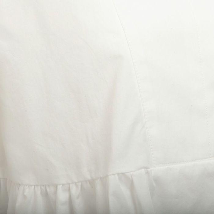タイプライター素材 スタンドカラーペプラムシャツ