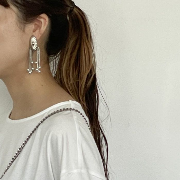 TOGA/Metal motif earrings